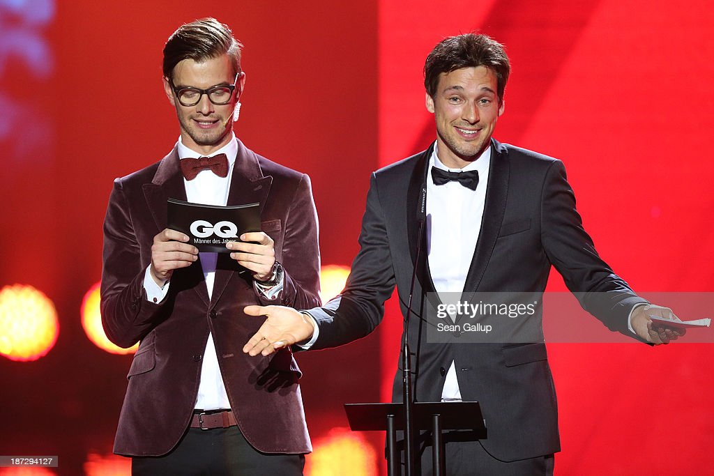 (TO BE USED EXCLUSIVELY FOR POST-EVENT REPORTING TO GQ MEN OF THE YEAR 2013, DO NOT USE AFTER) Joko Winterscheidt (L) and <a gi-track='captionPersonalityLinkClicked' href=/galleries/search?phrase=Florian+David+Fitz&family=editorial&specificpeople=4218706 ng-click='$event.stopPropagation()'>Florian David Fitz</a> on stage at the GQ Men Of The Year Award at Komische Oper on November 7, 2013 in Berlin, Germany.