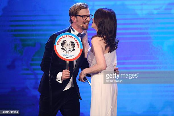 Joko Winterscheidt and Iris Berben are seen on stage at the GQ Men Of The Year Award 2014 at Komische Oper on November 6 2014 in Berlin Germany