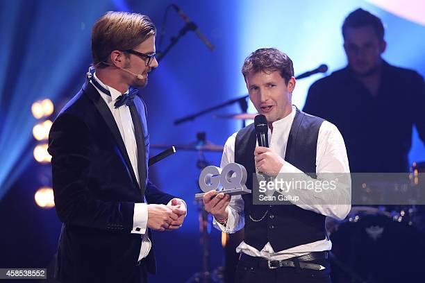 Joko Winterscheidt and James Blunt are seen on stage at the GQ Men Of The Year Award 2014 at Komische Oper on November 6 2014 in Berlin Germany