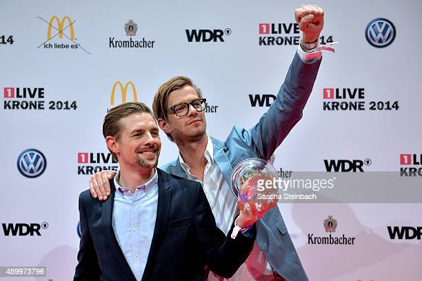 Joko Winterscheidt and Klaas HeuferUmlauf pose with the award during the 1Live Krone 2014 at Jahrhunderthalle on December 4 2014 in Bochum Germany