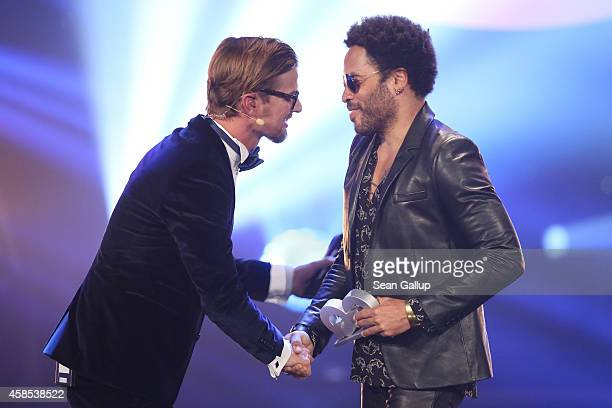 Joko Winterscheidt and Lenny Kravitz are seen on stage at the GQ Men Of The Year Award 2014 at Komische Oper on November 6 2014 in Berlin Germany