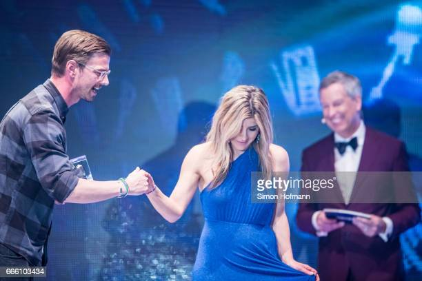 Joko Winterscheidt is awarded by Panagiota Petridou during the Radio Regenbogen Award 2017 at Europapark on April 7 2017 in Rust Germany