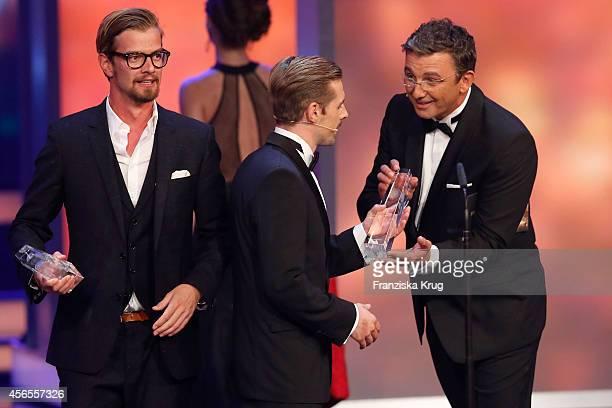 Joko Winterscheidt Klaas HeuferUmlauf and Hans Sigl attend the Deutscher Fernsehpreis 2014 show on October 02 2014 in Cologne Germany