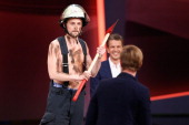 Joko Winterscheidt smiles as Klaas HeuferUmlauf dressed up as a firefighter attends the 'Wetten dass' TV Show from Dusseldorf at the ISS Dome on...
