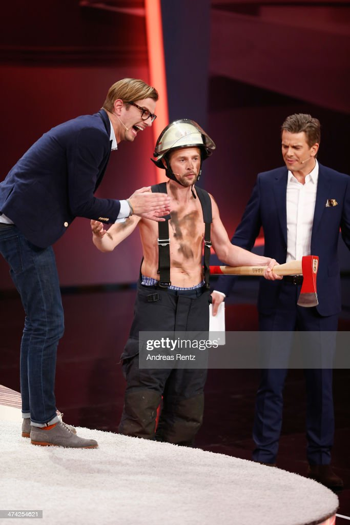 Joko Winterscheidt (L) smiles as Klaas Heufer-Umlauf, dressed up as a firefighter, attends the 'Wetten, dass..?' TV Show from Dusseldorf at the ISS Dome on February 22, 2014 in Duesseldorf, Germany..