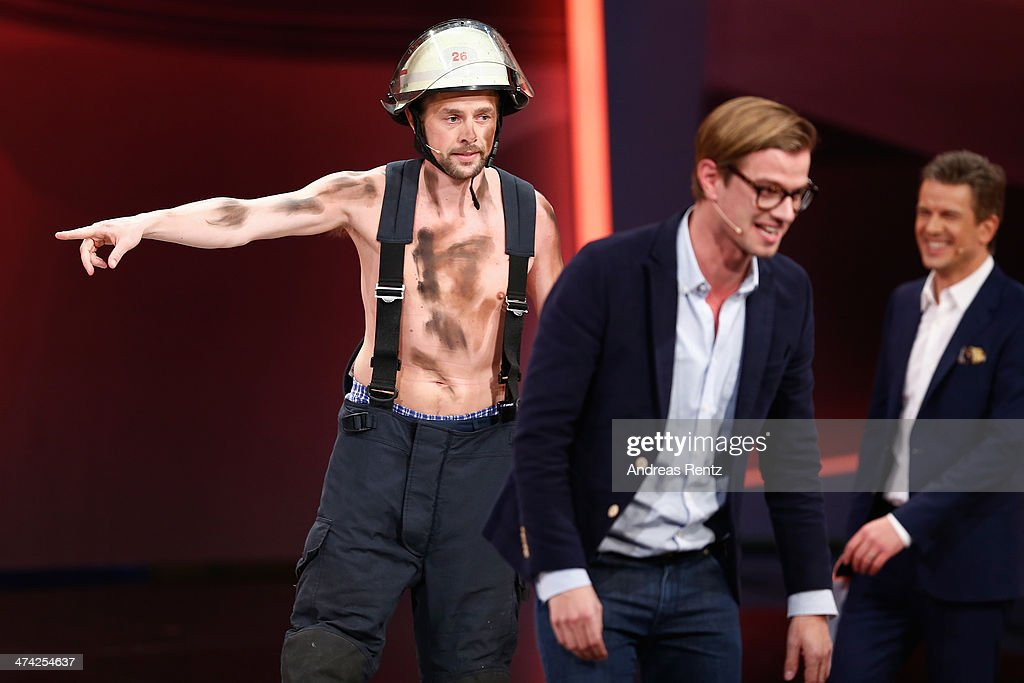 Joko Winterscheidt (C) smiles as Klaas Heufer-Umlauf, dressed up as a firefighter, attends the 'Wetten, dass..?' TV Show from Dusseldorf at the ISS Dome on February 22, 2014 in Duesseldorf, Germany..