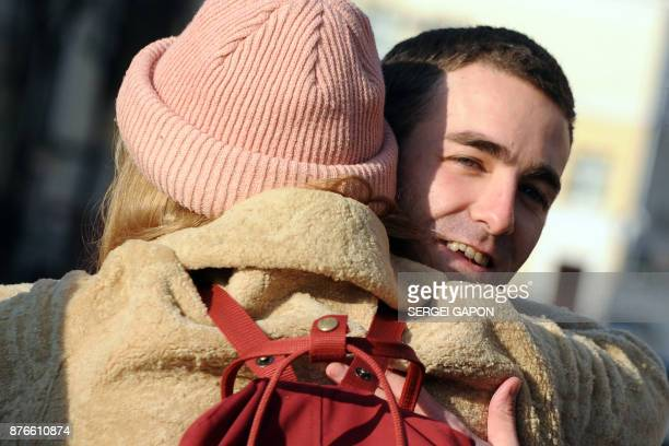 Jolan Viaud from France who was arrested for transporting a munition while entering Belarus from Ukraine hugs his friend after he was released at a...