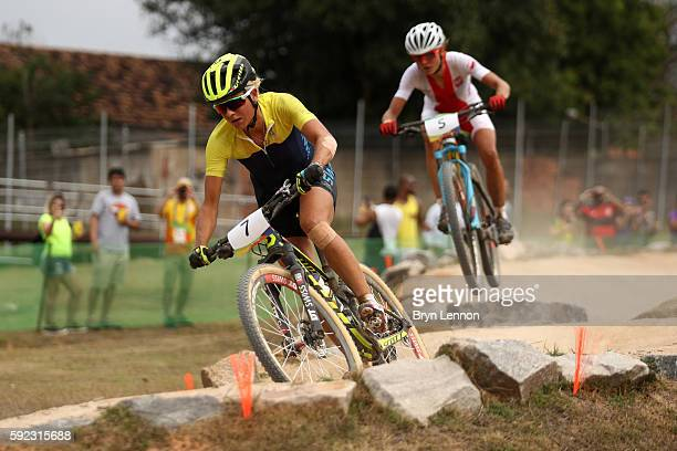 Jolanda Neff of Poland and Jenny Rissveds of Sweden race during the Women's CrossCountry Mountain Bike Race on Day 15 of the Rio 2016 Olympic Games...