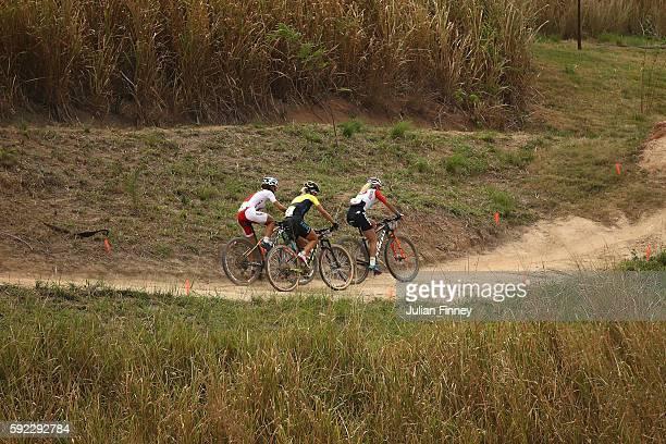 Jolanda Neff of Poland Jenny Rissveds of Sweden and Maja Wloszczowska of Poland race during the Women's CrossCountry Mountain Bike Race on Day 15 of...