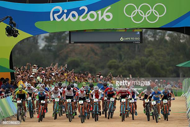 Jolanda Neff of Poland leads a group at the start during the Women's CrossCountry Mountain Bike Race on Day 15 of the Rio 2016 Olympic Games at the...