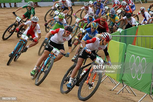 Jolanda Neff of Poland leads a group during the Women's CrossCountry Mountain Bike Race on Day 15 of the Rio 2016 Olympic Games at the Mountain Bike...