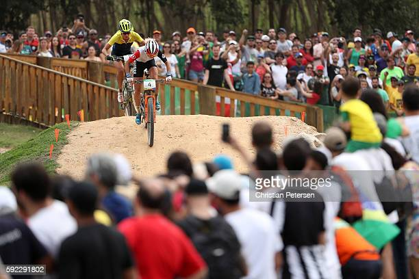 Jolanda Neff of Poland races during the Women's CrossCountry Mountain Bike Race on Day 15 of the Rio 2016 Olympic Games at the Mountain Bike Centre...