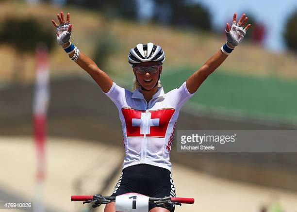 Jolanda Neff of Switzerland celebrates as she crosses the line to win gold in the Women's Crosscountry Mountain Bike Cycling during day one of the...