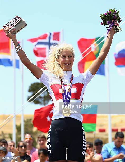 Jolanda Neff of Switzerland celebrates with her gold medal after winning the Womens' Crosscountry Mountain Bike Cycling during day one of the Baku...