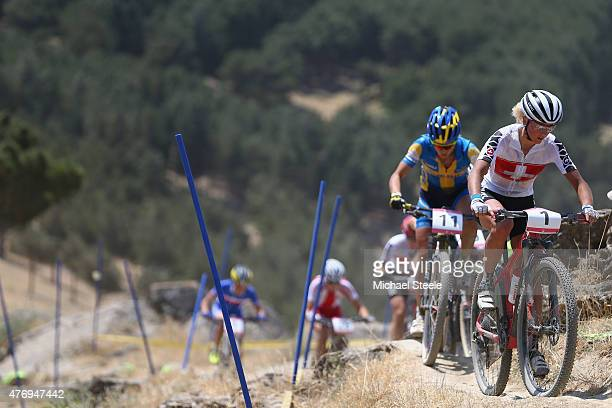 Jolanda Neff of Switzerland leads from Jenny Rissveds of Sweden on her way to winning gold in the Womens' Crosscountry Mountain Bike Cycling during...