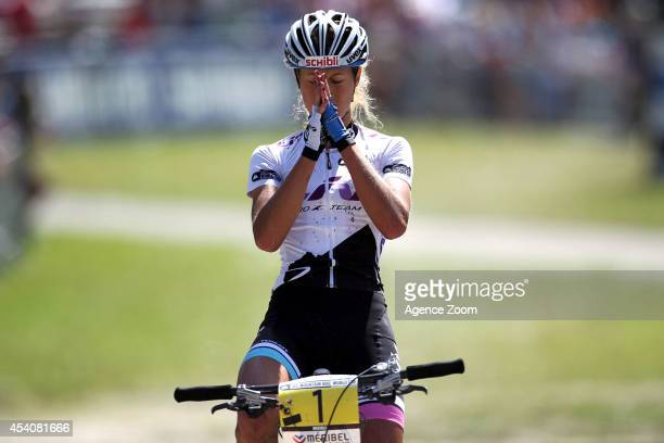 Jolanda Neff of Switzerland takes 1st place and wins glob during the UCI Mountain Bike World Cup Crosscountry Olympic on August 24 2014 in Meribel...