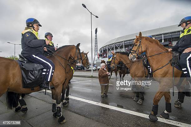 Jolanda Schouten age 93 gives the police horses for 23 years some suger cubes during the Dutch Cup Final match between PEC Zwolle and FC Groningen on...