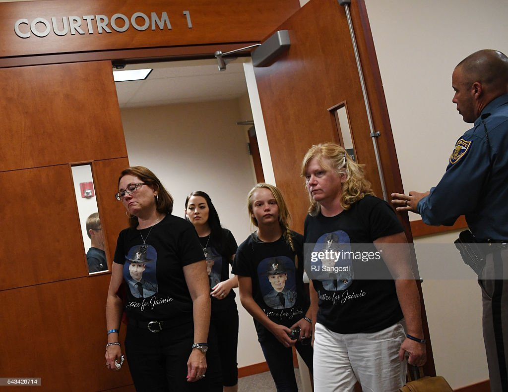 Jolene Torres, left, mother of Colorado State Patrol Trooper Jaimie Jursevics, walks out of the Douglas County courthouse during a break in the sentencing hearing for Eric Henderson in the death of Jursevics, June 28, 2016.