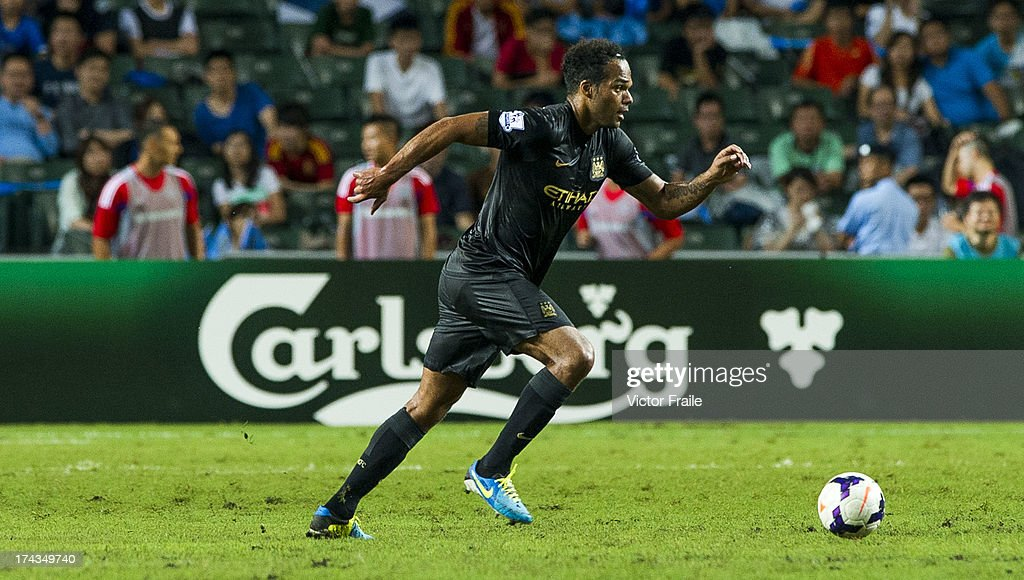 Joleon Lecott of Manchester City runs with the ball during the Barclays Asia Trophy Semi Final match between Manchester City and South China at Hong Kong Stadium on July 24, 2013 in So Kon Po, Hong Kong.