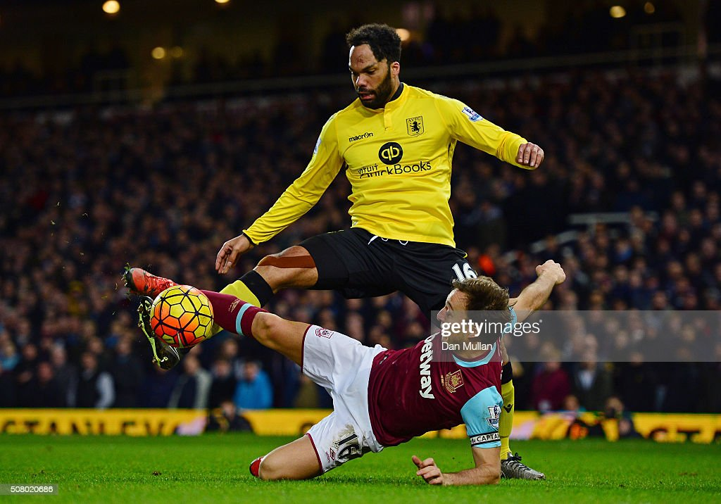 Joleon Lescott of Aston Villa and Mark Noble of West Ham United compete for the ball during the Barclays Premier League match between West Ham United and Aston Villa at the Boleyn Ground on February 2, 2016 in London, England.