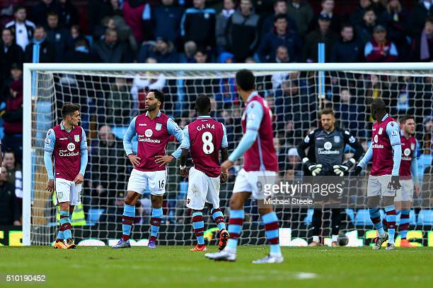 Joleon Lescott of Aston Villa and teammates show their dejection during the Barclays Premier League match between Aston Villa and Liverpool at Villa...