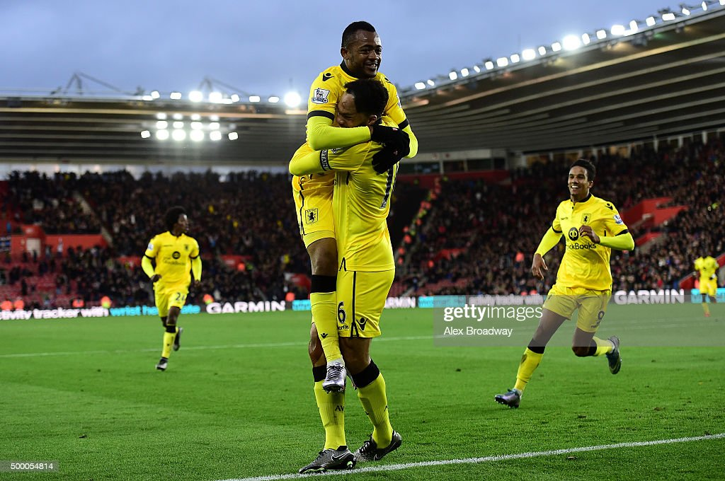 Joleon Lescott of Aston Villa celebrates scoring his team's frist goal with his team mate Jordan Ayew during the Barclays Premier League match...