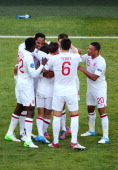 Joleon Lescott of England celebrates scoring the first goal with team mates during the UEFA EURO 2012 group D match between France and England at...
