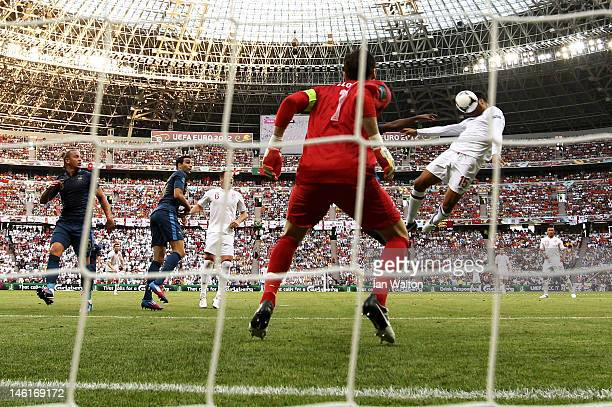 Joleon Lescott of England heads the ball past Hugo Lloris of France to score their first goal during the UEFA EURO 2012 group D match between France...