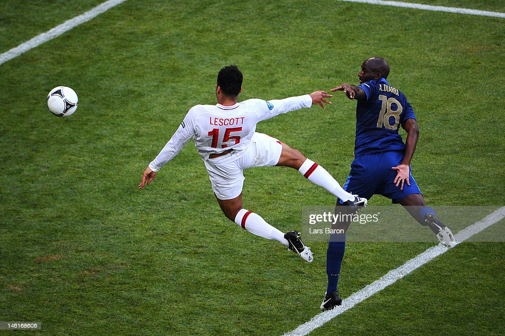 <a gi-track='captionPersonalityLinkClicked' href=/galleries/search?phrase=Joleon+Lescott&family=editorial&specificpeople=687246 ng-click='$event.stopPropagation()'>Joleon Lescott</a> of England scores the first goal during the UEFA EURO 2012 group D match between France and England at Donbass Arena on June 11, 2012 in Donetsk, Ukraine.