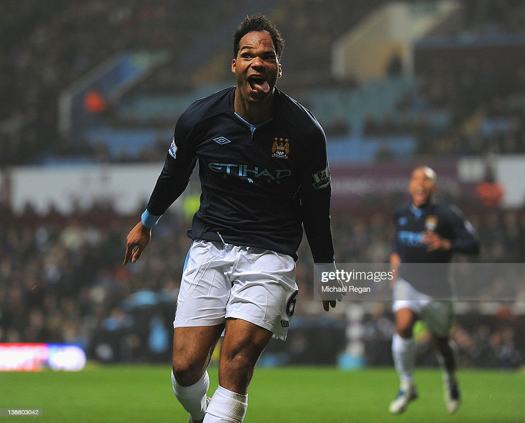 <a gi-track='captionPersonalityLinkClicked' href=/galleries/search?phrase=Joleon+Lescott&family=editorial&specificpeople=687246 ng-click='$event.stopPropagation()'>Joleon Lescott</a> of Man City celebrates scoring to make it 1-0 during the Barclays Premier league match between Aston Villa and Manchester City at Villa Park on February 12, 2012 in Birmingham, England.
