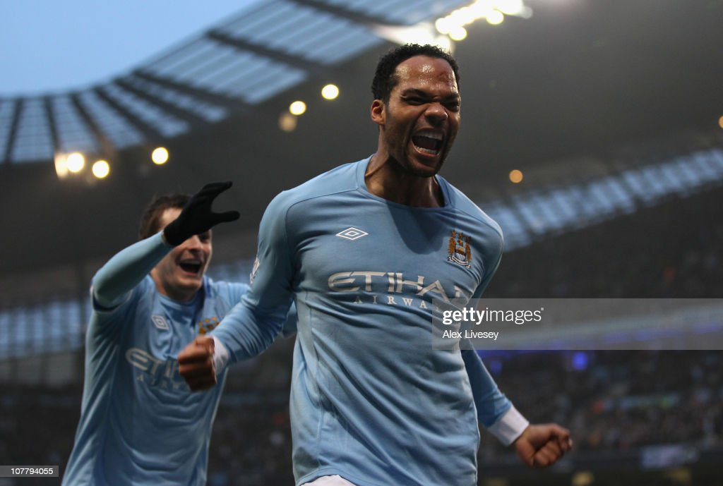<a gi-track='captionPersonalityLinkClicked' href=/galleries/search?phrase=Joleon+Lescott&family=editorial&specificpeople=687246 ng-click='$event.stopPropagation()'>Joleon Lescott</a> of Manchester City celebrates after scoring the second goal during the Barclays Premier League match between Manchester City and Aston Villa at the City of Manchester Stadium on December 28, 2010 in Manchester, England.