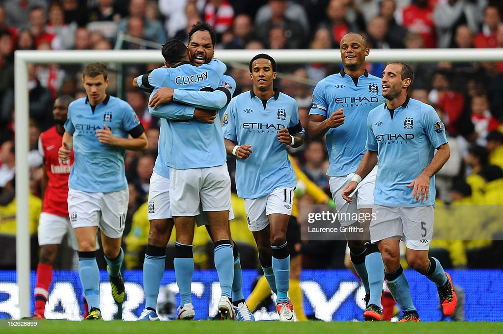 Joleon Lescott of Manchester City celebrates scoring the first goal with his Gael Clichy of Manchester City during the Barclays Premier League match between Manchester City and Arsenal at Etihad Stadium on September 23, 2012 in Manchester, England.