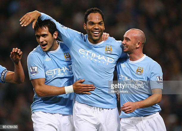 Joleon Lescott of Manchester City celebrates with Roque Santa Cruz and Stephen Ireland after scoring his goal during the Carling Cup 4th Round match...