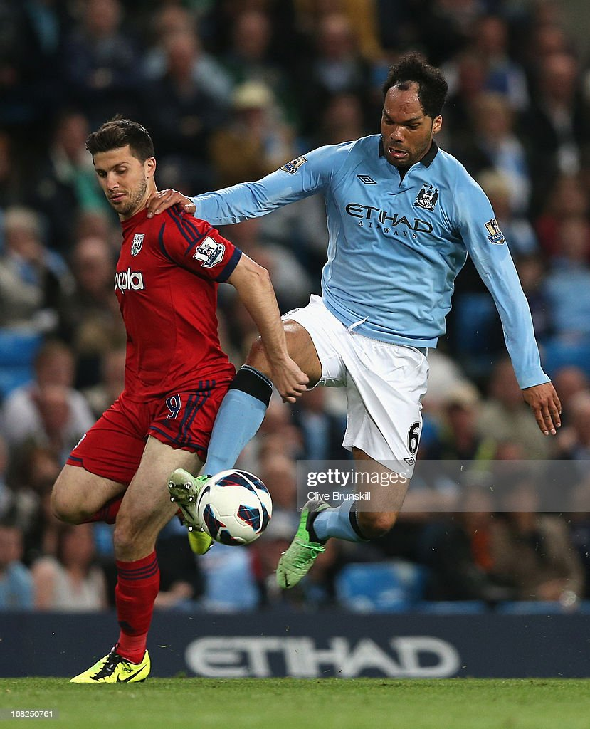 Joleon Lescott of Manchester City competes with Shane Long of West Bromwich Albion during the Barclays Premier League match between Manchester City and West Bromwich Albion at the Etihad Stadium on May 07, 2013 in Manchester, England.