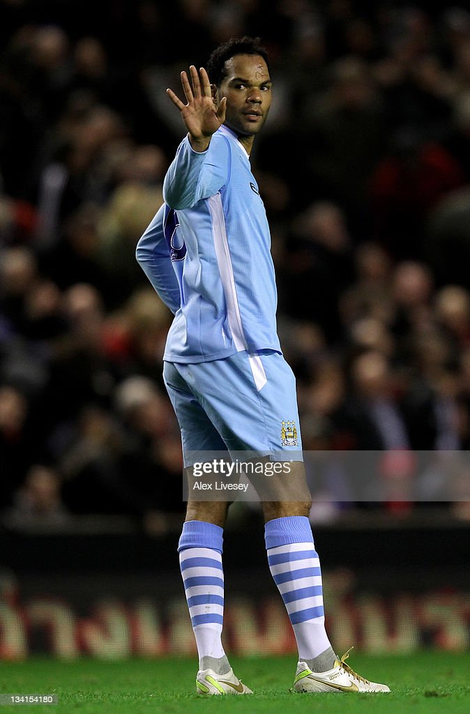 <a gi-track='captionPersonalityLinkClicked' href=/galleries/search?phrase=Joleon+Lescott&family=editorial&specificpeople=687246 ng-click='$event.stopPropagation()'>Joleon Lescott</a> of Manchester City makes a gesture of apology to team mate Joe Hart after scoring an own goal during the Barclays Premier League match between Liverpool and Manchester City at Anfield on November 27, 2011 in Liverpool, England.