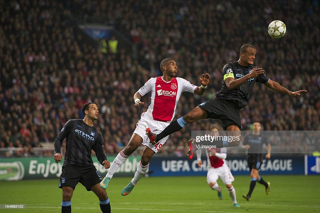 Joleon Lescott of Manchester City, Ryan Babel of Ajax, Vincent Kompany of Manchester City during the Champions League match between Ajax Amsterdam and Manchester City at the Amsterdam Arena on October 24, 2012 in Amsterdam, The Netherlands.