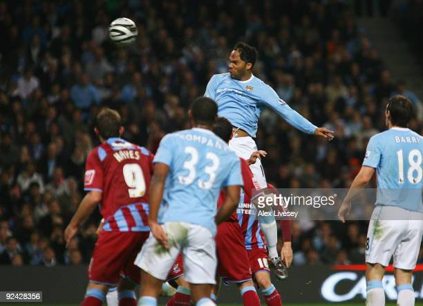 Joleon Lescott of Manchester City scores his goal during the Carling Cup 4th Round match between Manchester City and Scunthorpe United at the City of...