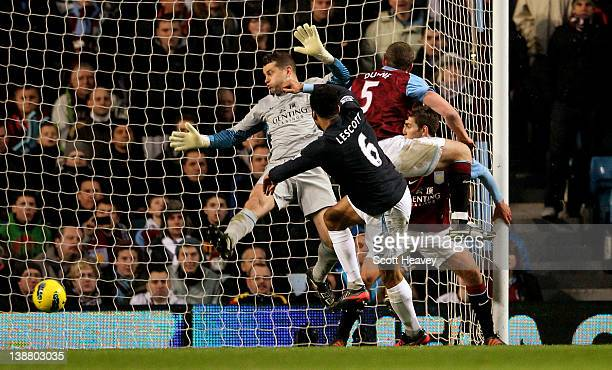 Joleon Lescott of Manchester City scores the opening goal past Shay Given of Aston Villa during the Barclays Premier League match between Aston Villa...