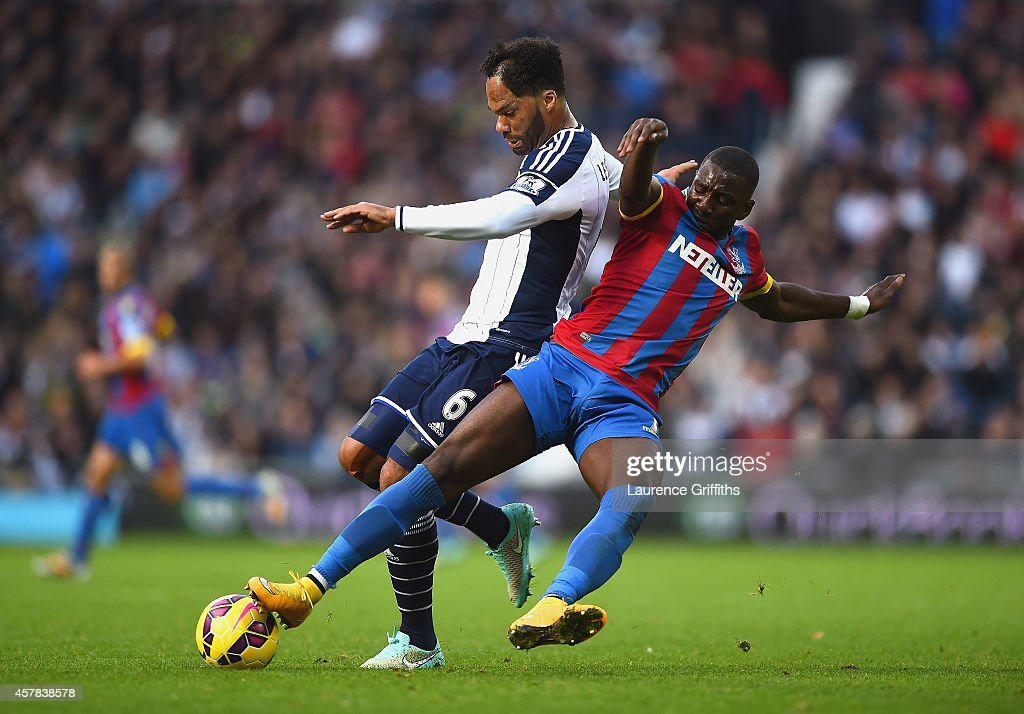 Joleon Lescott of West Brom and Yannick Bolasie of Crystal Palace fight for the ball during the Barclays Premier League match between West Bromwich Albion and Crystal Palace at The Hawthorns on October 25, 2014 in West Bromwich, England.