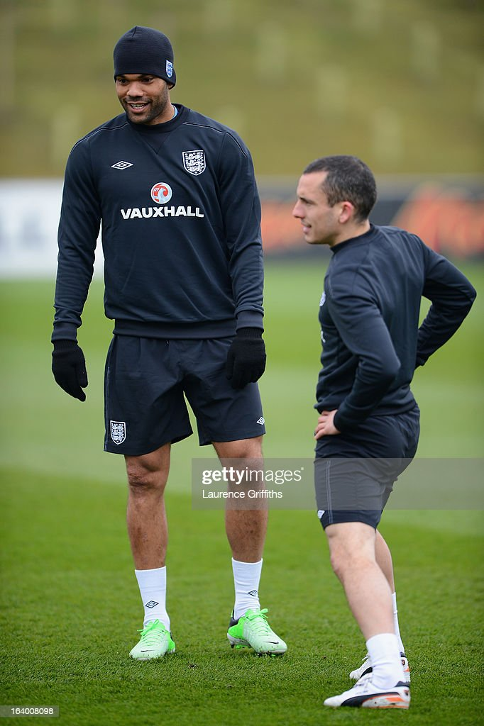 Joleon Lescott talks with Leon Osman during a training session at St Georges Park on March 19, 2013 in Burton-upon-Trent, England.