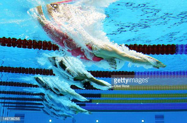 Jolien Sysmans of Belgium dives into the water at the start of the Women's 50m Freestyle heat 7 on Day 7 of the London 2012 Olympic Games at the...