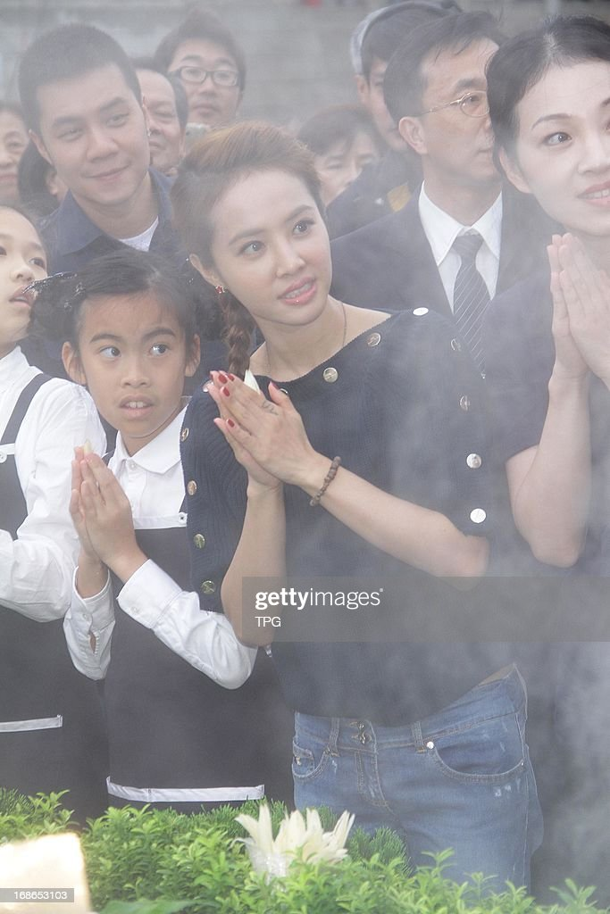Jolin Tsai attended a Buddha bathing ceremony with her mother on Mother's Day on Sunday May 12, 2013 in Taipei, Taiwan, China.