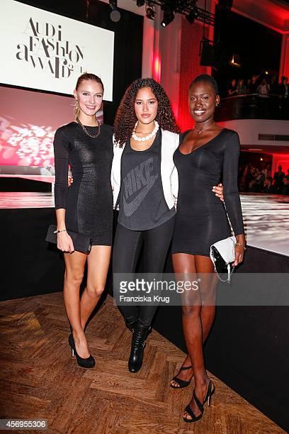 Jolina Fust Lovelyn Enebechi and Aminata Sonogo attend the Audi Fashion Award 2014 on October 09 2014 in Hamburg Germany