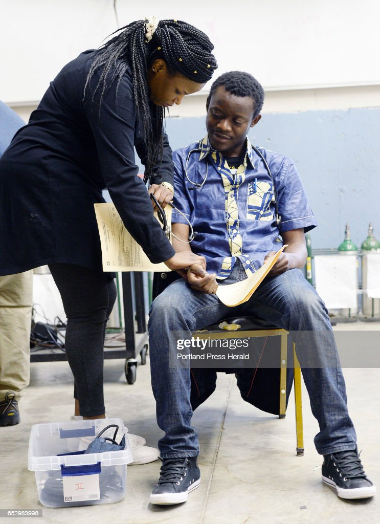 Jolly Ntirumenyerwa of Portland, originally from the Democratic Republic of Congo does a medical assesment on Axels Samuntu of Portland, who is also originally from the Democratic Republic of Congo Thursday, March 9, 2017. The two are taking part in a new program at SMCC that focuses on training immigrants to become EMT's.