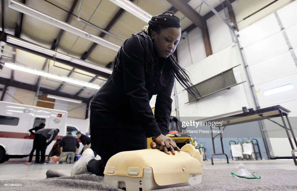 Jolly Ntirumenyerwa of Portland, originally from the Democratic Republic of Congo performs CPR on a training manikin at SMCC Thursday, March 9, 2017. Ntirumenyerwa taking part in a new program at SMMC that focuses on training immigrants to become EMT's.
