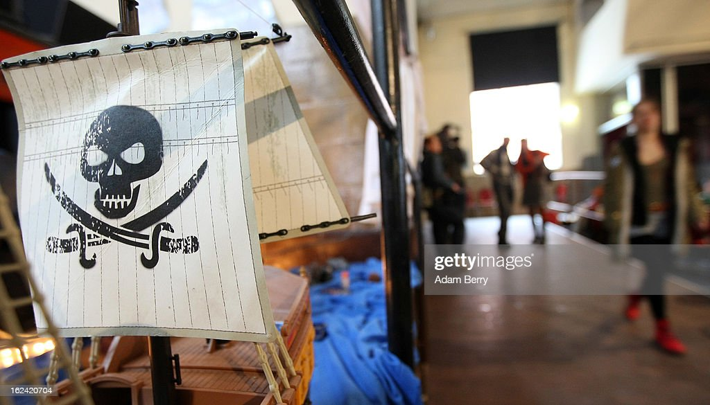 A jolly roger flag hangs on a toy pirate ship during a meeting of the Berlin chapter of the German Pirate Party on February 23, 2013 in Berlin, Germany. After successes in 2011 in regional elections in the German capital and in the following year in the states of Schleswig-Holstein and North Rhine-Westphalia, the German Pirate Party (Piratenpartei), which initially focused on filesharing, censorship and data protection, has seen two of its state-level leaders in the states of Brandenburg and Baden-Wuerttemburg step down in the past few days alone. The party's Berlin representation is meeting over the weekend to choose its candidates for the country's federal elections, to be held on September 22, 2013, which will determine the 598 or more members of the 18th Bundestag, Germany's federal parliament. After well-publicized infighting in the party, many observers are skeptical that the party can reach the 5 percent vote required to join the country's politics on that level.