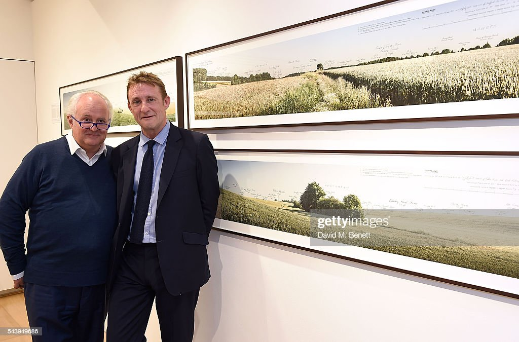 Jolyon Fenwick (L) and Gerry Farrell attend the exhibition launch party of 'The Zero Hour Panoramas' by Jolyon Fenwick. The exhibition consists of 14 photographic panoramas showcasing, '100 Years on: Views From The Parapet of the Somme', at Sladmore Contemporary on June 30, 2016 in London, England.