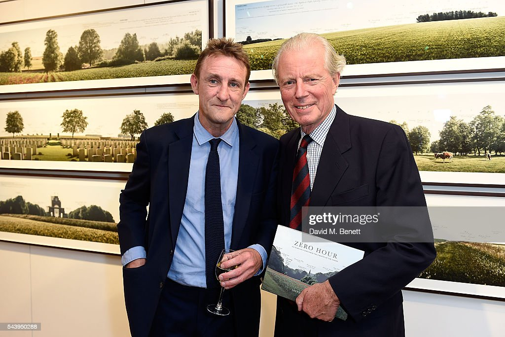 Jolyon Fenwick and Major General Michael Scott attend the exhibition launch party of 'The Zero Hour Panoramas' by Jolyon Fenwick. The exhibition consists of 14 photographic panoramas showcasing, '100 Years on: Views From The Parapet of the Somme', at Sladmore Contemporary on June 30, 2016 in London, England.