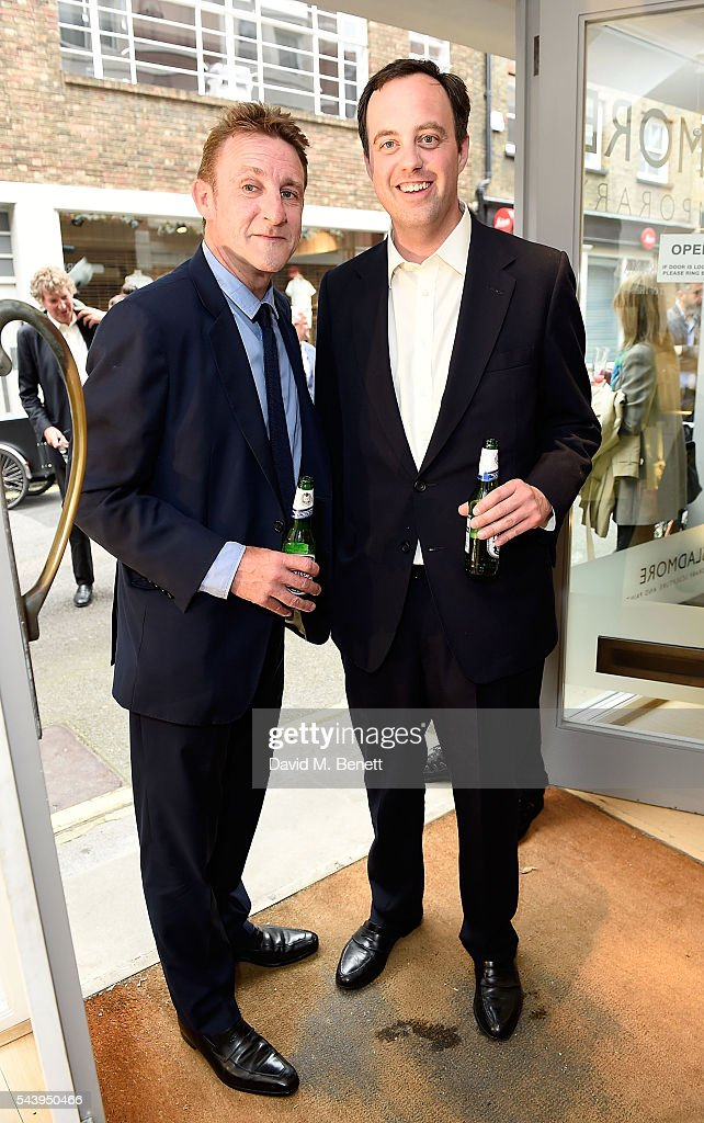 Jolyon Fenwick and William Buckhurst attend the exhibition launch party of 'The Zero Hour Panoramas' by Jolyon Fenwick. The exhibition consists of 14 photographic panoramas showcasing, '100 Years on: Views From The Parapet of the Somme', at Sladmore Contemporary on June 30, 2016 in London, England.