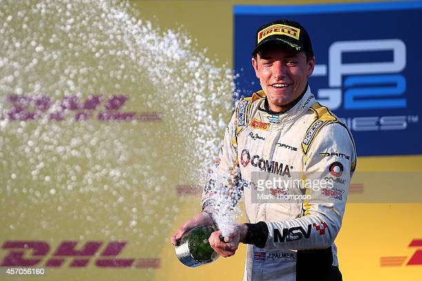 Jolyon Palmer of Great Britain and DAMS celebrates on the podium after victory in the Russian GP2 Series race held before the Russian Formula One...